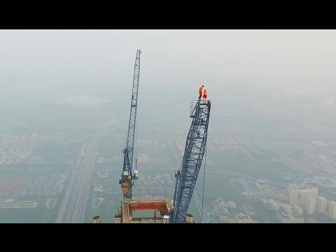 Couple Climbs The HIGHEST CONSTRUCTION SITE IN THE WORLD 640M – YouTube
