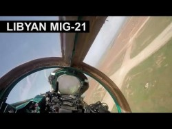 A Libyan Air Force MiG-21 passing very low over an airbase – YouTube