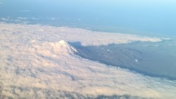 A Mountain cutting through the clouds