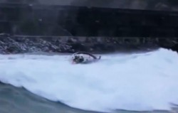 Video of yacht capsized by breaking wave