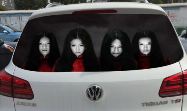 Drivers using freaky reflective face decals to discourage high-beam users