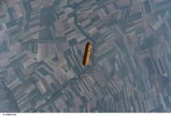 Space Shuttle External Fuel Tank Falling Toward Earth