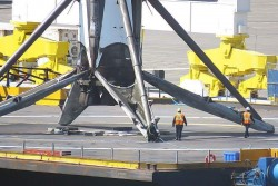 SpaceX landing is even more impressive when you see the booster next to humans.