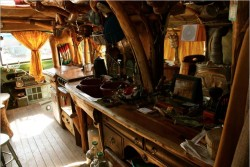 Check out the wooden detailing in this rustic bus conversion's open-plan kitchen