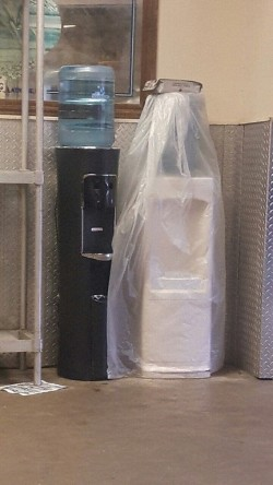 These water dispensers look like they're getting married.