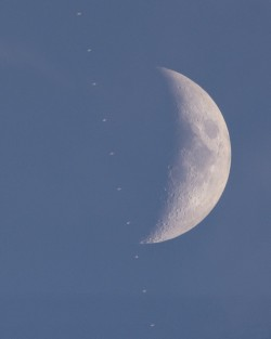 The ISS crossing in front of crescent moon during an uncommon daytime lunar transit.