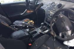 Apple MacBook bursts into flames on the passenger seat and the driver says someone could have di ...
