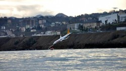 Plane dangles off cliff after skidding off runway in Turkey; it's a 'miracle'  ...