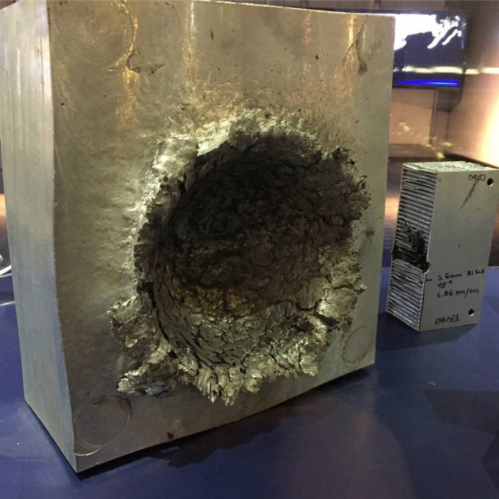 This is what happens to aluminium when a 1/2 oz piece of plastic hits it at 15,000 mph in space