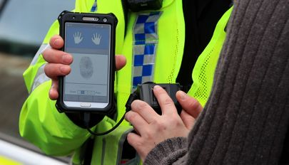 UK police are now using fingerprint scanners on the streets to identify people in less than a mi ...