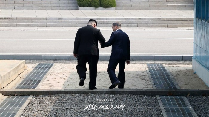 What a photo. This is actually the unscripted moment Kim encouraged Moon to step briefly into th ...
