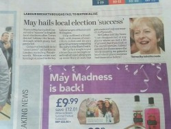 Unfortunate ad placement or an editor making a less than subtle point??