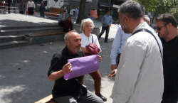 Turkish police intervene against protester with blank sign | Ahval