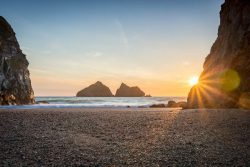 Sunset at Holywell Bay in Cornwall. The sand dunes here were used as a location to film the Deme ...
