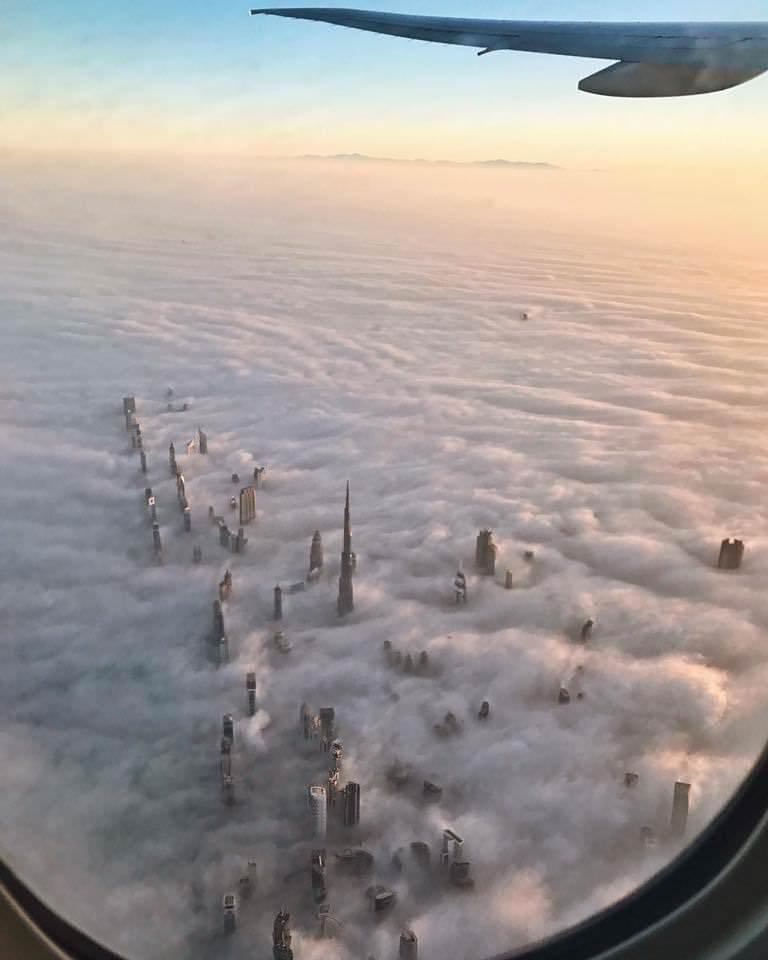 Dubai's towers through the fog