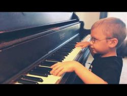 6 year old blind boy plays/sings Bohemian Rhapsody