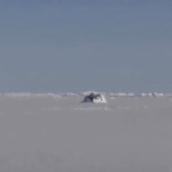 Submarine breaching through ice