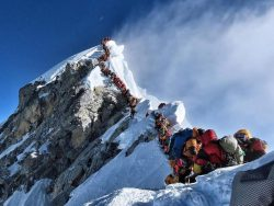 Mount Everest suffers 'traffic jam' after two climbers die near summit