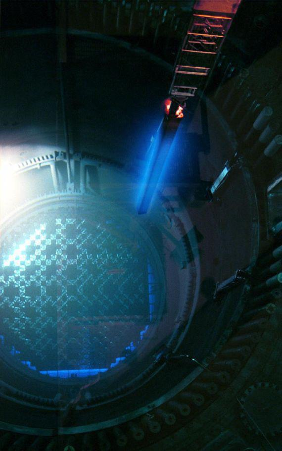 Cherenkov Radiation coming off a fresh fuel rod being lowered into a reactor.