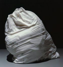 A marble statue of a trashbag