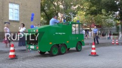 Kids invited to use toy water cannon 'to feel like real policemen' at Berlin festival — RT Viral