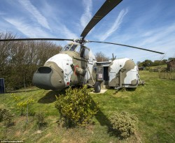Campsite owner spends £30k converting disused Royal Navy chopper into two-bedroom let | Daily Ma ...