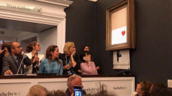 """Banksy's """"Girl with Balloon"""" shreds itself after being sold for over £1M at th ..."""