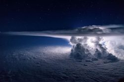 Thunderstorms developing at 37,000 ft over the Pacific Ocean