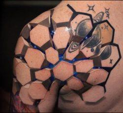 A regular tattoo inside of an amazing tattoo