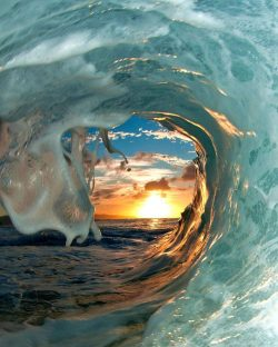 Sunset through a breaking wave