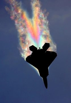 An F-22 Raptor pulling so many Gs the low pressure air over the fuselage gets cold enough for th ...