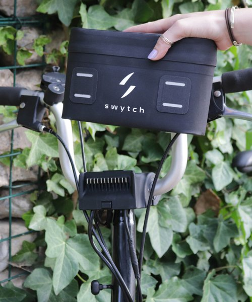 hand-held 'swytch kit' turns regular bikes into electric