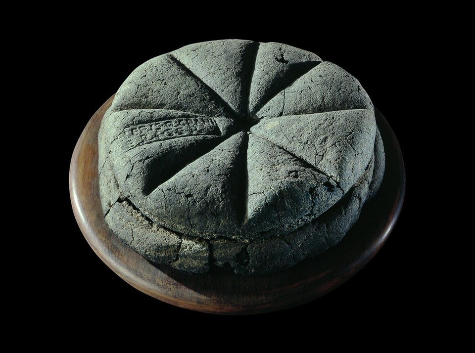 A preserved bread from Pompeii (79 AD). It has a bakers stamp which marked individual loaves tha ...