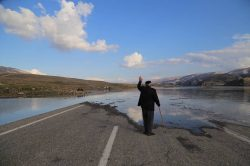 Goodbye Hasankeyf, a relocated villager waves goodbye to his home as a village inhabited since p ...