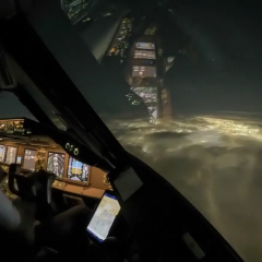 Time lapse of a pilot descending into a city at night