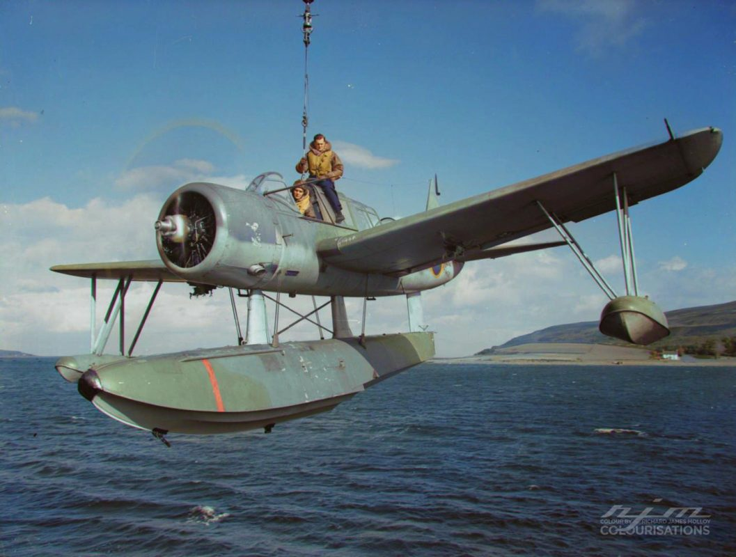"""HMS Pegasus, Lamlash, Scotland, September 1942. """"A Kingfisher being lowered. The observer  ..."""