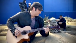 I didn't think he could get any cuter (Baby Yoda, not director Robert Rodriguez jamming wi ...