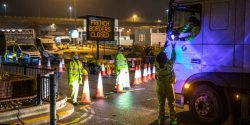 Salvation Army volunteers fed some of the 1,500 truck drivers stranded in Kent after France clos ...