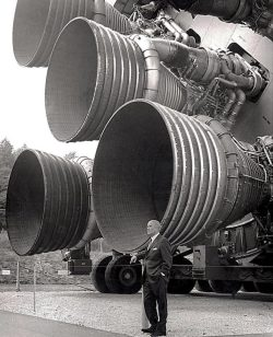 Dr Von Braun stands next to the F-1 engines of the Saturn V Dynamic test vehicle