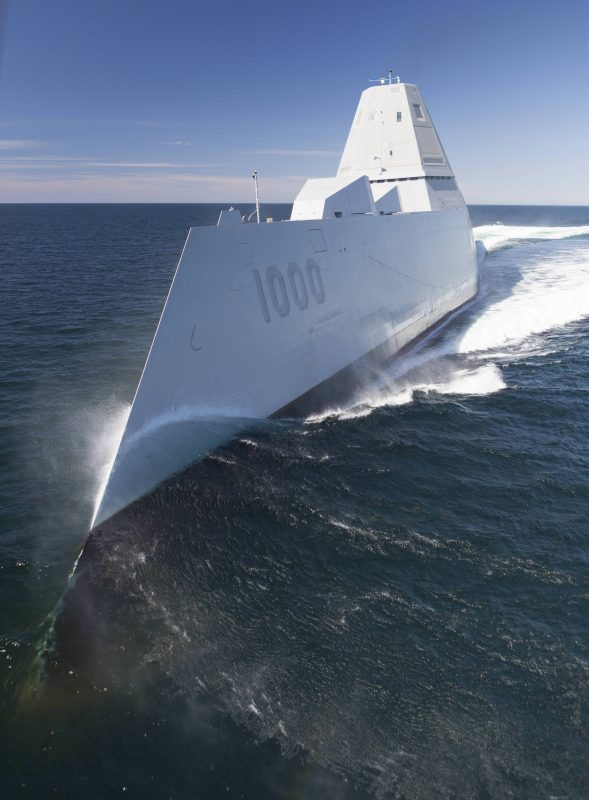 USS Zumwalt cutting through the water.