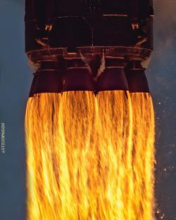 9 Powerful Merlin Rocket Engines Propelling a Falcon 9 rocket engine away from earth and into orbit.