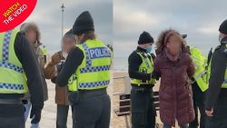 Woman arrested while 'sitting on a bench' as police get tough on lockdown rules R ...