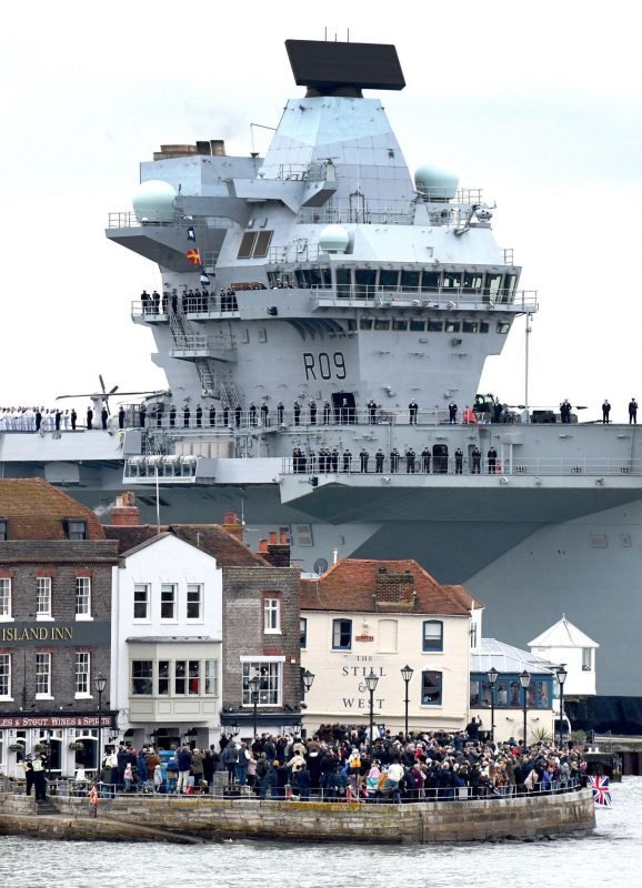 HMS Prince of Wales towering over Old Portsmouth