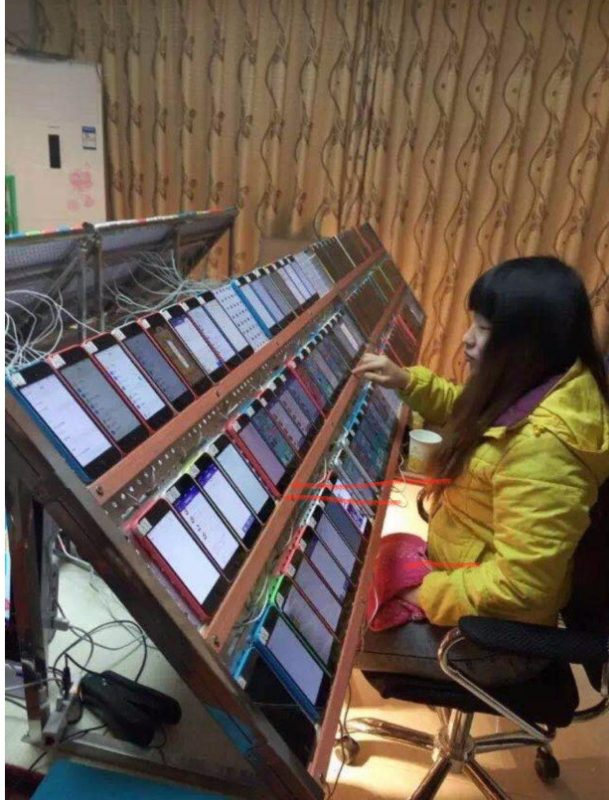 A click farm in Asia where low paid workers are used to inflate video views and trick advertiser ...