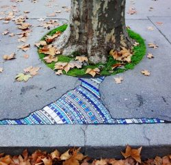 In Lyon, an artist nicknamed Emem fills the pavement holes with mosaics. A man calls it the art  ...