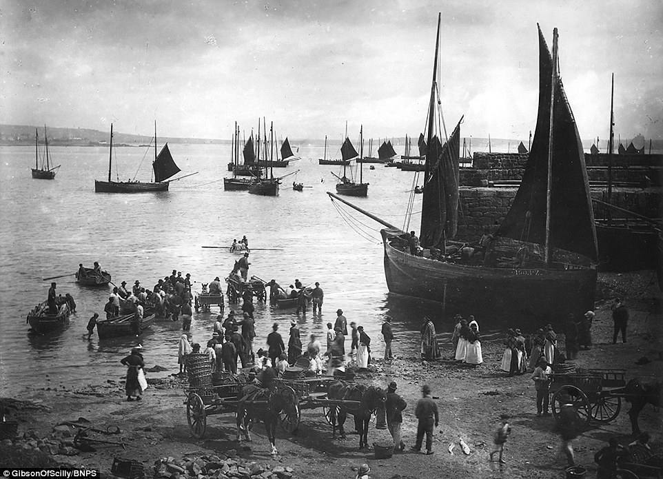 This image of the fishing port of Newlyn on the south coast of Cornwall around 1900 is one of mo ...