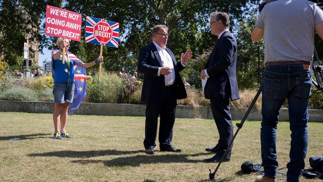 Why don't Brexiteers like to talk about Brexit any more?  As a Remain protestor holds up p ...
