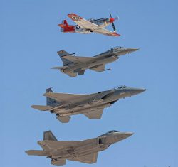 P-51 Mustang, F-16 Fighting Falcon, F-15 Eagle and F-22 Raptor inflight
