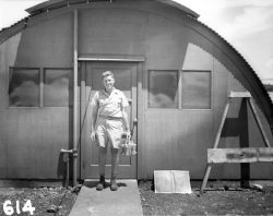Physicist Harold Agnew smiles while holding the plutonium core of the fat man bomb that would la ...