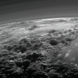 Plutos ice mountains frozen plains and layers of atmospheric haze as seen by the New Horizons sp ...
